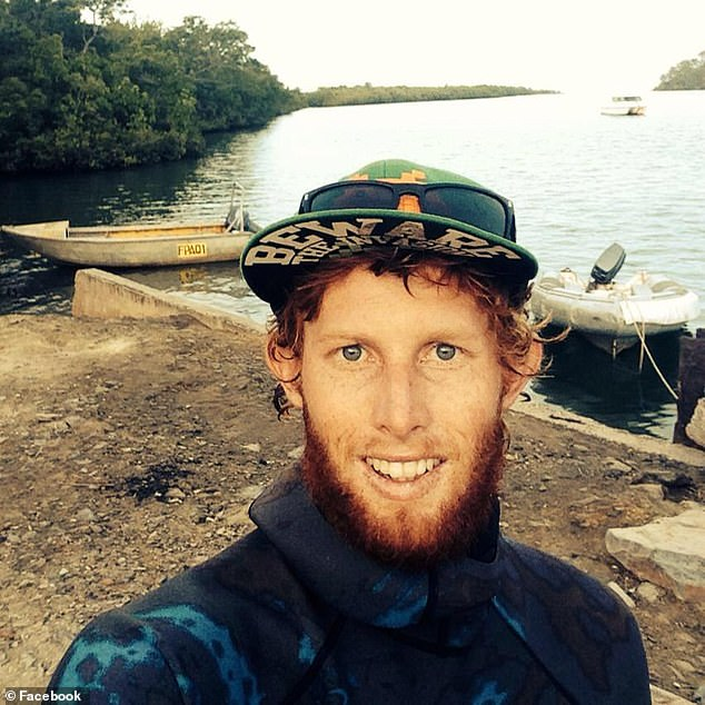 Mr Dunn (pictured) said the 4.5metre beast swam underneath his tinny and growled at him before he started filming