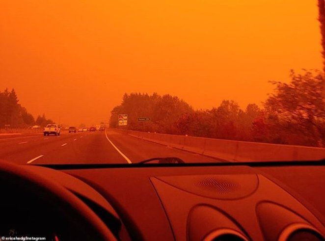 More than 80,000 people in Oregon were evacuated from their homes on Tuesday as 35 separate fires blazed out of control, covering more than 367,000 acres. Pictured: A roadway is blanketed in an orange haze