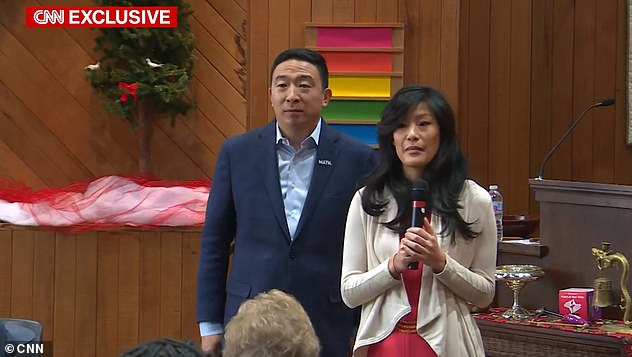 Andrew Yang said he was 'extraordinarily proud' of his wife Evelyn (pictured together) for telling her story in January and no one deserves to be treated as she was