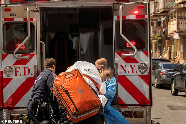 New York City Fire Department (FDNY) and Emergency Medical Technicians (EMT) wearing personal protective equipment lift a man after moving him from a nursing home into an ambulance during an ongoing outbreak of the coronavirus disease (COVID-19) in the Brooklyn borough of New York, U.S., April 16, 2020