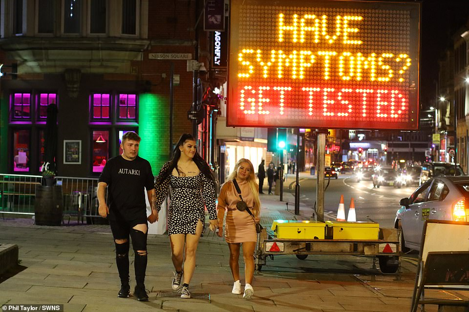 Revellers take to the streets in Bolton city centre after further coronavirus lockdown measures were put in place