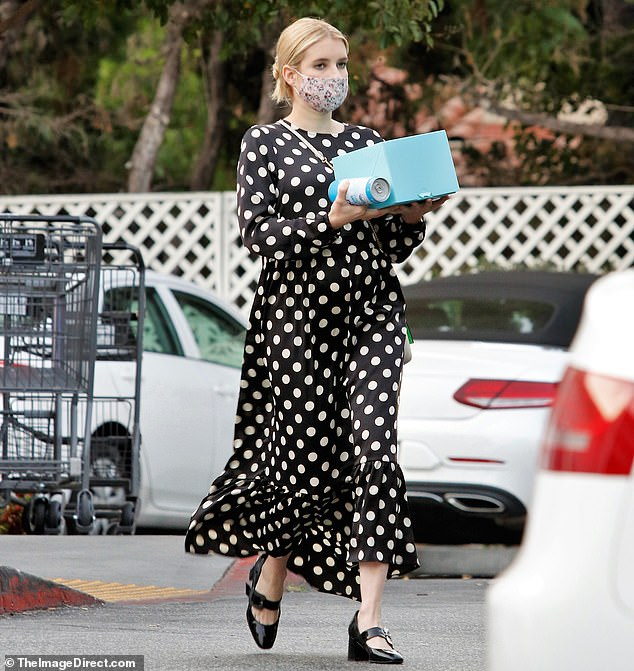 Pregnant Emma Roberts shows a hint of her growing bump in a polka dot dress while shopping in LA