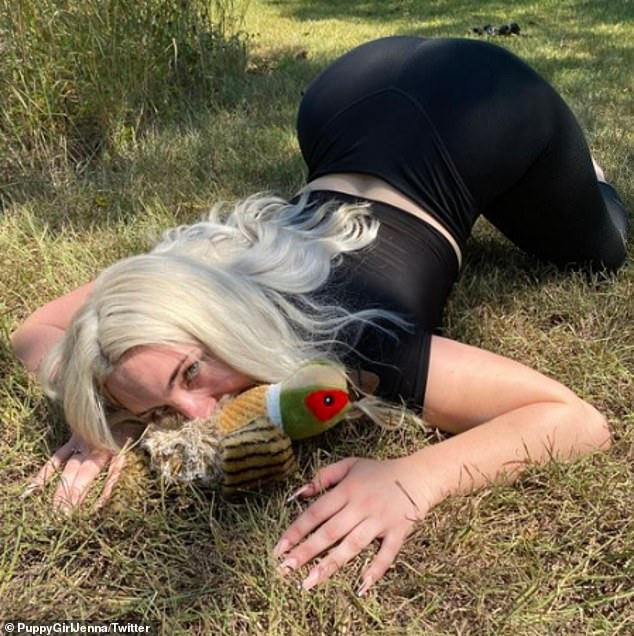 Puppy play: Jenna Phillips, 21, from Austin, Texas, has a fetish for acting like a puppy. She is best known as 'Puppy Girl Jenna' on TikTok, where she has earned more than 196,000 fans