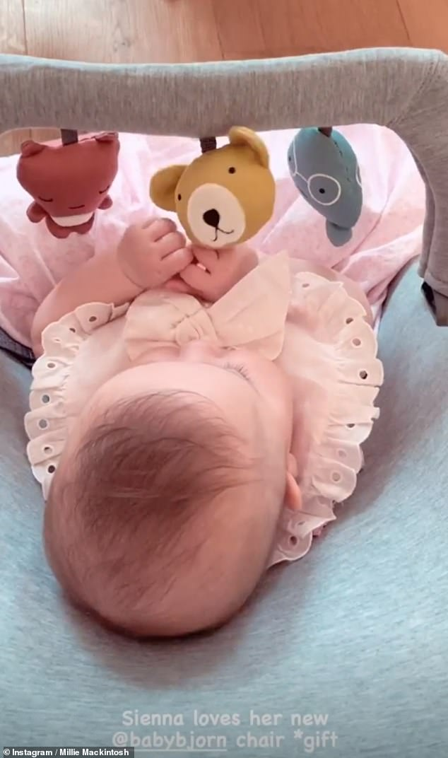 At peace:After returning home from her workout, the influencer enthused her little one is 'loving' her new bouncer by Babybjörn
