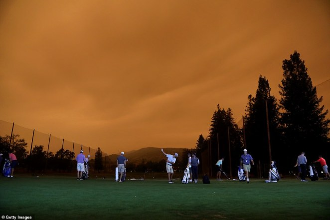 Golfers warm up on the driving range during the preview day of the Safeway Open in Napa, California, on Wednesday