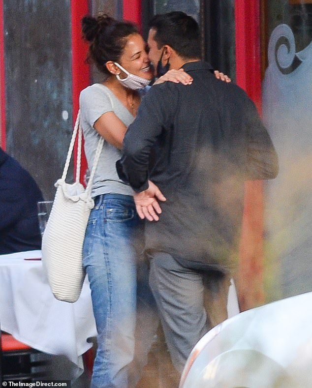 The look of love! Katie Holmes and new boyfriend Emilio Vitolo Jr. pack on some serious PDAs at his father's famous Nolita restaurant, Emilio's Ballato, which is frequented by stars including Whoopi Goldberg and Bradley Cooper