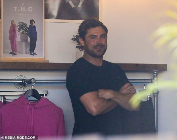 As if the cat has got the cream!  Zac Efron confirmed his relationship with banged-up waitress Vanessa Valladers during a solo shopping trip in Byron Bay on Monday