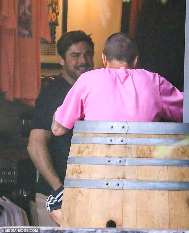Friendly: Zac was high spirits as he browsed the rack in the store and talked to the staff