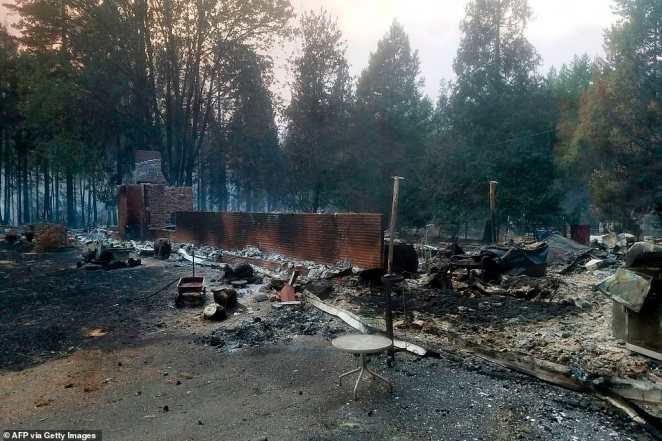 A burned out house is seen after the passing of the Holiday Farm fire in McKenzie Bridge, Oregon on Wednesday
