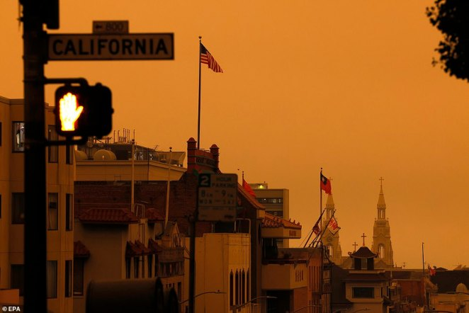 California wildfire smoke high in the atmosphere over the San Francisco Bay Area blocked the sunlight and turned the sky a dark orange and yellow shade for most of the day on Wednesday