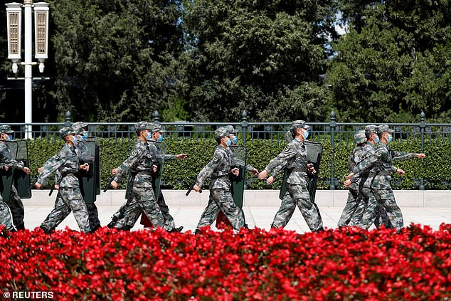 Soldiers of the People's Liberation Army march outside the Great Hall of the People in Beijing