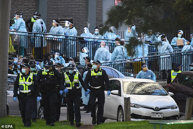 A Melbourne cleaning company was told by the health department not to send home staff it had deemed close contacts of an infected employee. Pictured: People prepare to enter a COVID plagued housing tower in July