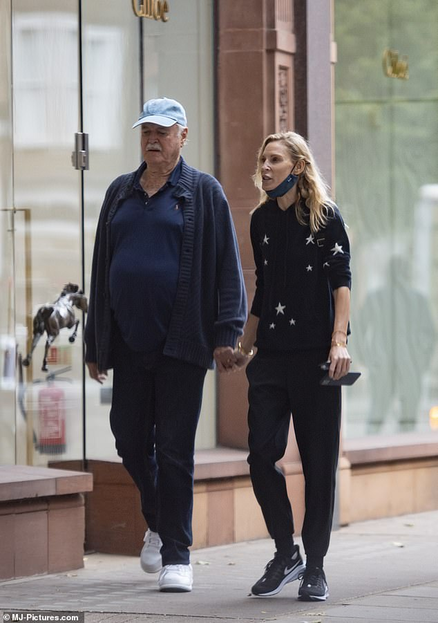 Cute couple: John Cleese, 80, and wife Jennifer Wade, 48, still looked as loved up as ever as they headed out on a shopping spree in London on Thursday
