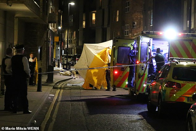 Police investigate a fall from a flat on Bacon Street, Shoreditch, which resulted in the death of a woman last night. The incident is being 'treated as non-suspicious'