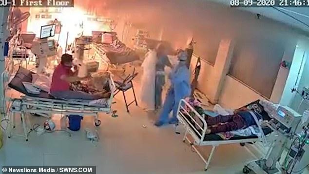 A ventilator caught fire inside a Covid-19 wardin SSG Hospital's ICU unit inVadodara, India asfour medics dressed in hazmats surround a patient on a hospital bed