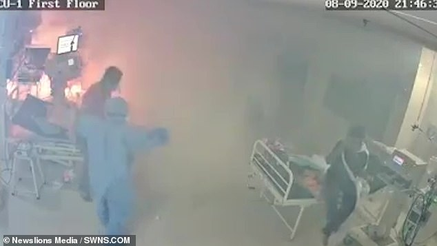 As they attempt to extinguish the fire the ward is barely recognisable as it is completely clouded with smoke