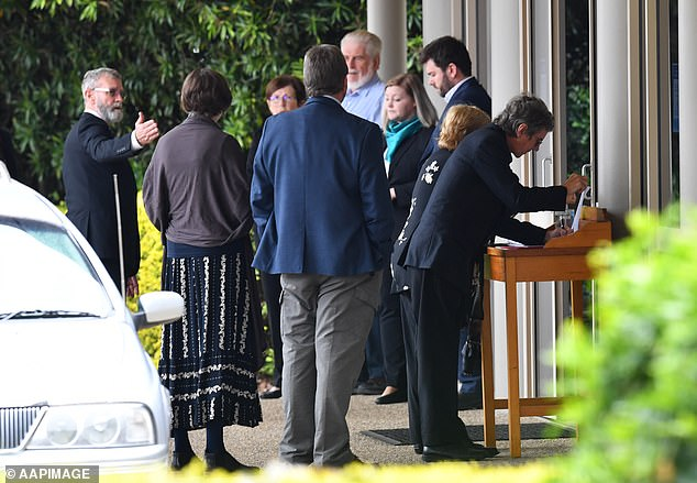 Mourners are seen at the funeral service for Bernard Prendergast in Brisbane on Thursday after Ms Caisip was not allowed to attend