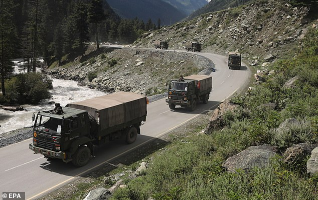 Indian army vehicles move along a highway leading to Ladakh on Wednesday as tensions rise on the border with China