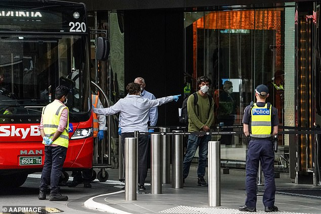 The review found it was common for guests not to answer calls, 'almost always for innocuous reasons' (Pictured: people going into hotel quarantine in March)