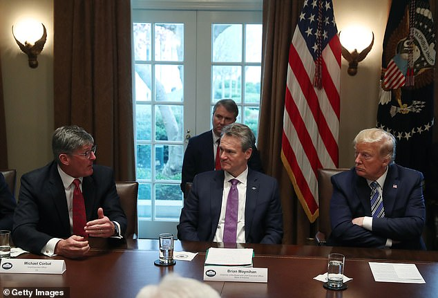 Donald Trump listens to Citigroup CEO Michael Corbat (left) and Bank of America CEO Brian Moynihan (center) during a meeting to discuss the coronavirus response in the Cabinet Room at the White House in March