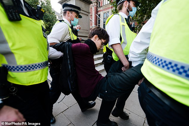 Arrest of activists from the Extinction Rebellion climate change group after the statue of Winston Churchill in Parliament Square was vandalised today