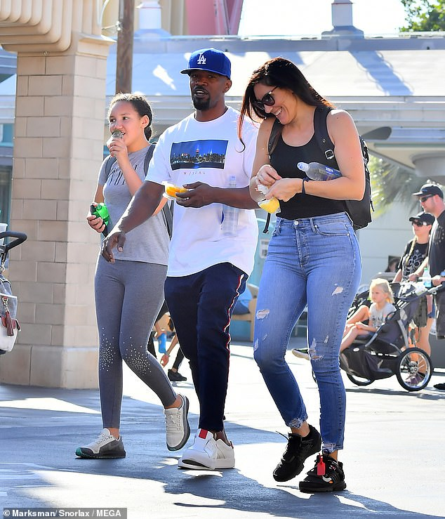 Holmes was upset by Foxx never giving up his roving eye and that he was still cozy with his ex-girlfriend and baby mama Kristin Grannis (pictured together with their daughter Annalise in July 2019) , according to the source