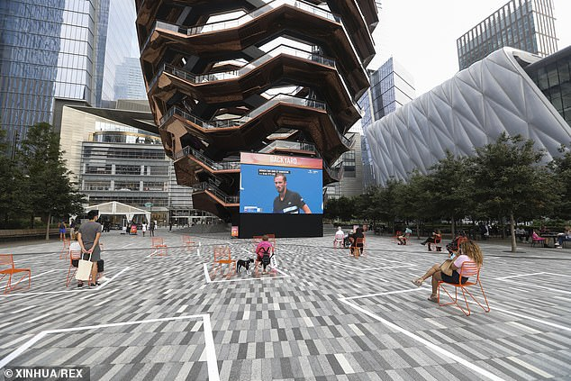 People are seen on the outdoor square in Hudson Yards in New York City on Wednesday