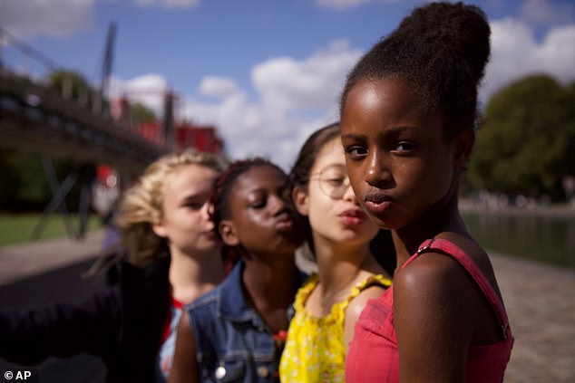 Cuties, tells the story of an 11-year-old Senegalese Muslim girl named Amy, pictured front