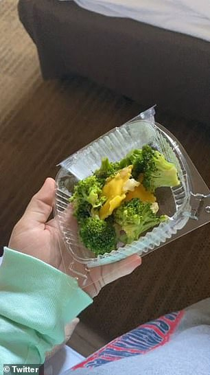 Another student shows the ravioli and broccoli they got for dinner