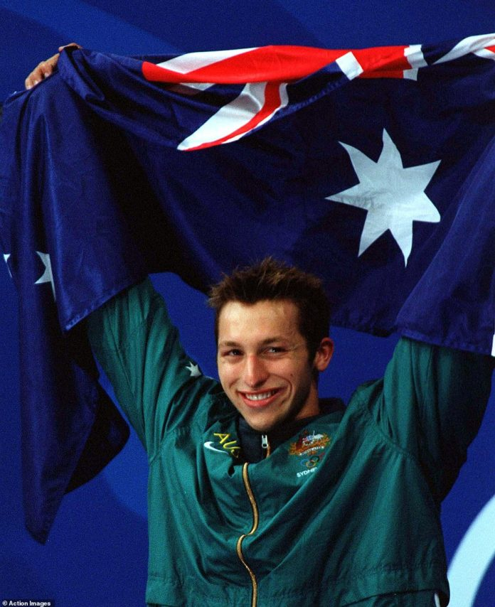 Ian Thorpe (pictured) holds aloft the Australian flag after winning the men's 400 metre relay event at the Sydney Olympics