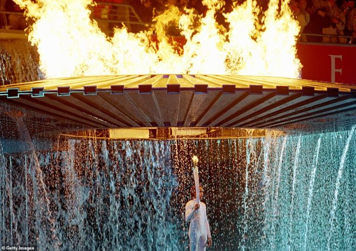 The Cauldron containing the Olympic Flame rises above Torch Bearer Cathy Freeman (pictured) of Australia during the Opening Ceremony of the Sydney 2000 Olympic Games at the Olympic Stadium in Homebush Bay