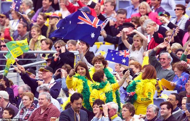 Australian fans joined international guests in the stadium (pictured) before the opening ceremony of the games