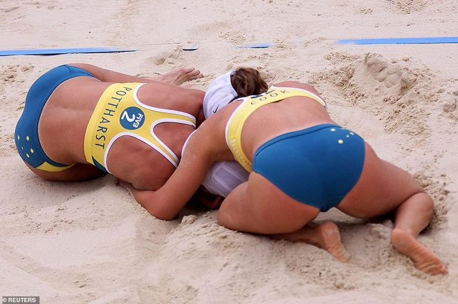 Australia's Natalie Cook (pictured right) celebrates with teammate Kerri-Ann Pottharst (pictured left) after defeating Brazil in the final of the women's beach volleyball competition at Bondi Beach, September 25, 2000