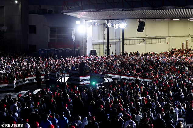 Trump is seen speaking to a crowd of several thousand supporters on Thursday night before heading back to DC