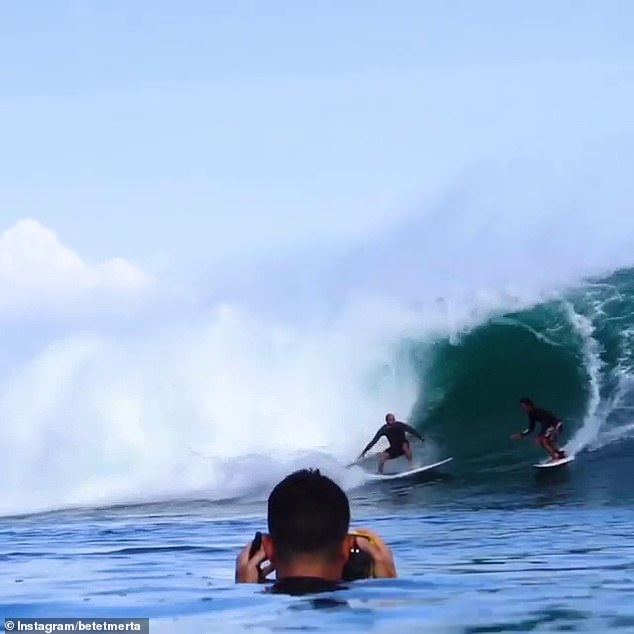 Pro surfers Merta and Slater (both pictured) were captured double-barrelling in a wave in Bali