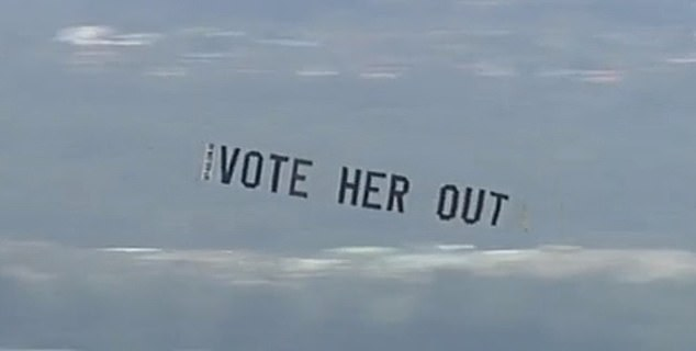 Footage showed the plane flying over the Gold Coast on Friday afternoon with a banner that read 'Vote Her Out', in reference to the state's upcoming election