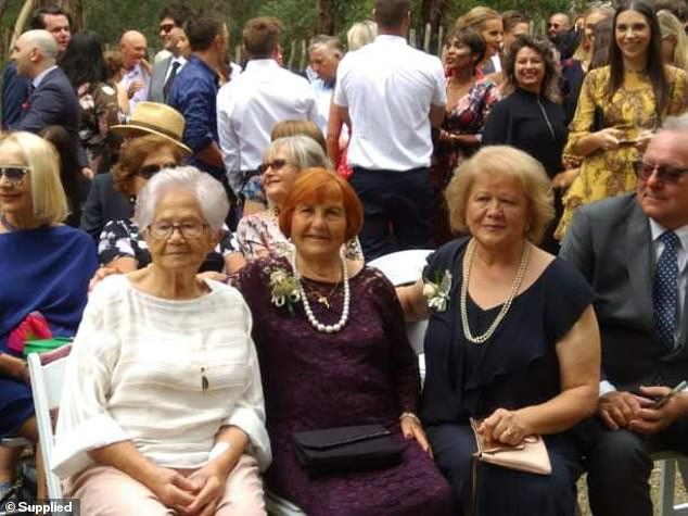 Ms Valente (centre) with family at Nicole's wedding when she was more mobile