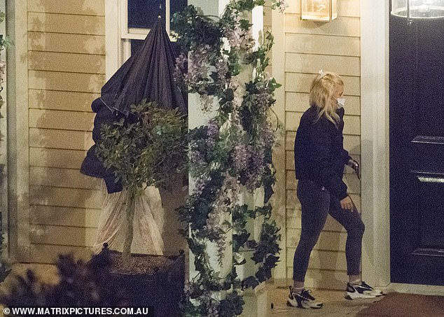 Off to the rose ceremony? Bella was also seen being led to the front door of the mansion by a member of production