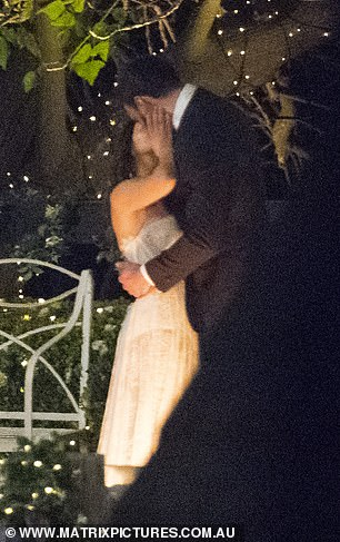 Steamy kiss: Bella and Locky enjoyed a steamy kiss in the mansion's gardens