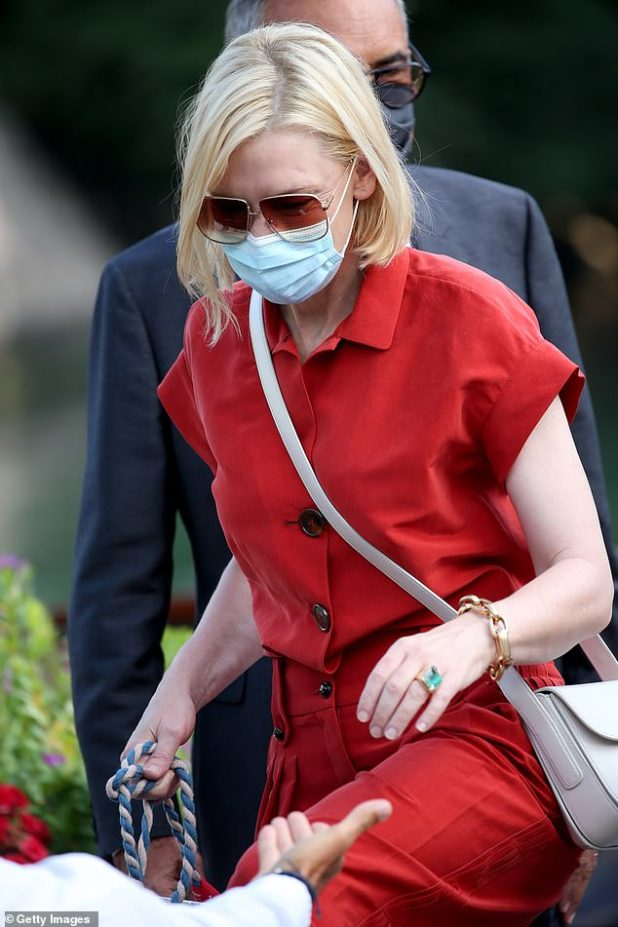 Star: Cate Blanchett looked effortlessly stylish in a red jumpsuit riding on a boat at the 77th Venice Film Festival on Friday