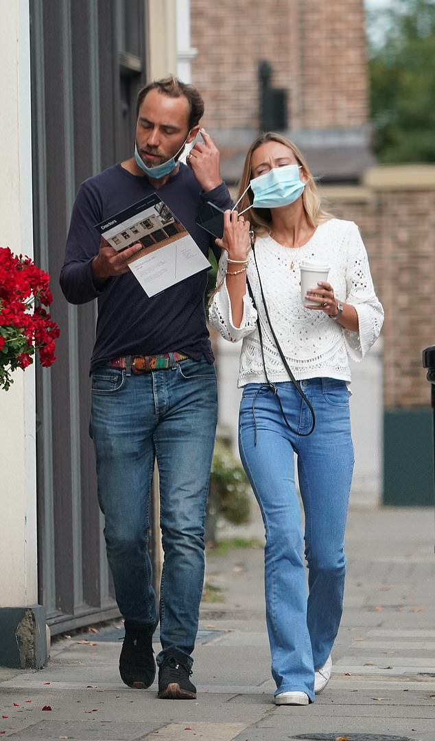 Getting comfortable: James andAlizée remove their face masks following the house viewing