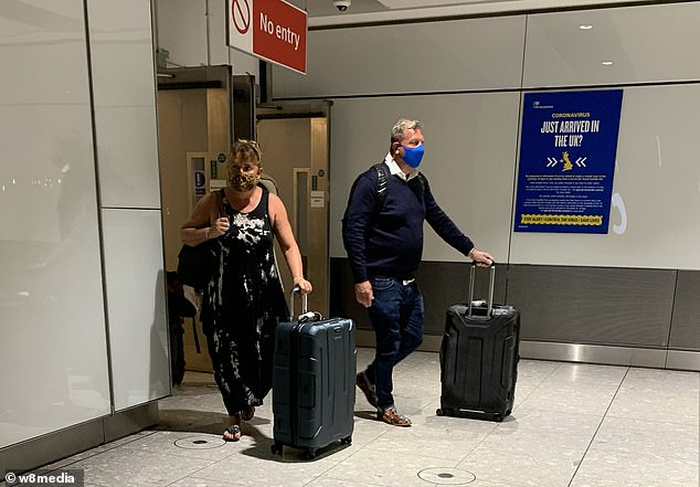 Heathrow, which before the Covid-19 pandemic was the busiest airport in Europe, said North American passenger numbers were down 95 per cent compared to last year as the quarantine rule deters long-haul travel (pictured: passengers arriving before the quarantine kicks in)