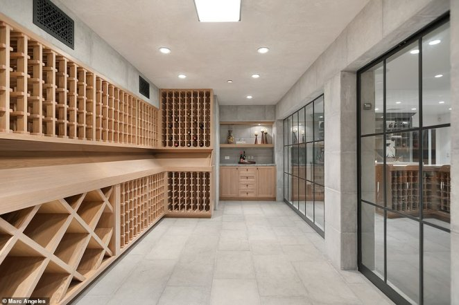 The wine cellar is large enough to fit ample bottles for the comedian's personal stash or for entertaining and throwing huge parties