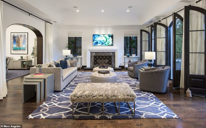 Arches in the doorways and dark wooden framing on the windows complete the contemporary Mediterranean style of the luxurious $16million home