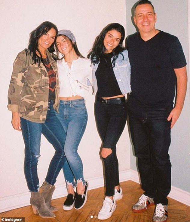 Close: Charli's sister Dixie, 19, and her parents, Marc and Heidi, have all found their own success online - and it has been reported that the family are filming their own reality show