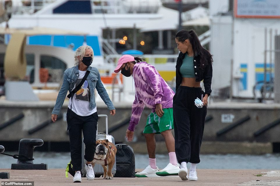 Puppy love: The group all paid plenty of attention to Lewis' pampered pet pooch Roscoe, who is famously vegan and likes to fly on private jets