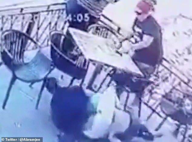 The restaurant owner holds down the 24-year-old attacker in a leg lock until police arrive to arrest him