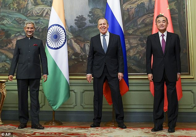 India's Foreign Minister S. Jaishankar, left, Russia's Foreign Minister Sergey Lavrov, and China's Foreign Minister Wang Yi, pose for a photo together on Thursday, the day an agreement was made between China and India to disengage troops from the tense border standoff