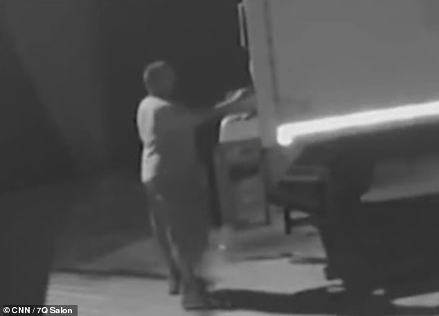 The unidentified man was filmed getting into the back of the Budget rental truck and chucking out mail