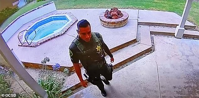 The sheriff's deputy was caught on security video allegedly stealing two safes, a rifle case and ceiling fans from a California home, days after he responded to the death of the elderly owner. Pictured Steve Hortz on his first visit allegedly breaking in to the home in his uniform